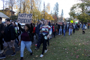 "Hundreds of students walk the streets of town yelling ""Not My President!"" during the Walkout for Solidarity Against Trump on Friday."